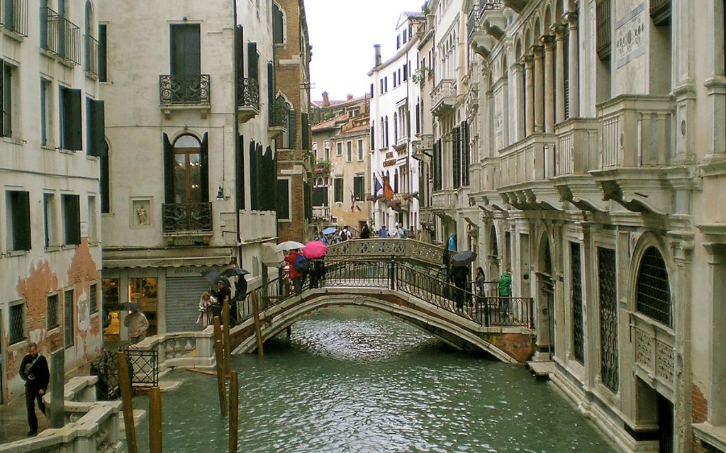 Crossing the bridge over Canal in Venice